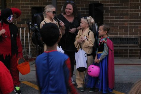 Since the children were busy collecting all the candy they could, not many people entered in the costume contest. Amongst those who entered, the siblings dressed up as ghost buster characters came in first place. In second place was Anna from Frozen and in third place was a clown.