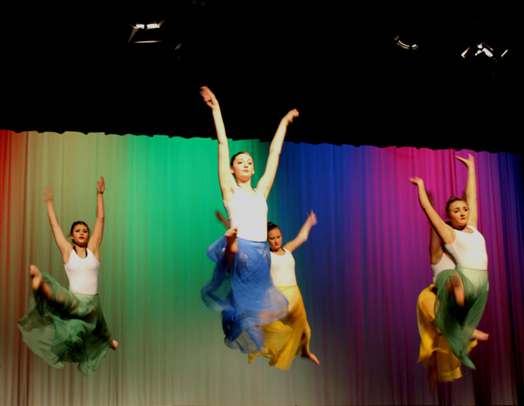 In+the+dance+ROYGBIV%2C+the+company+performs+grand+jet%C3%A9s+in+flowing+dresses.