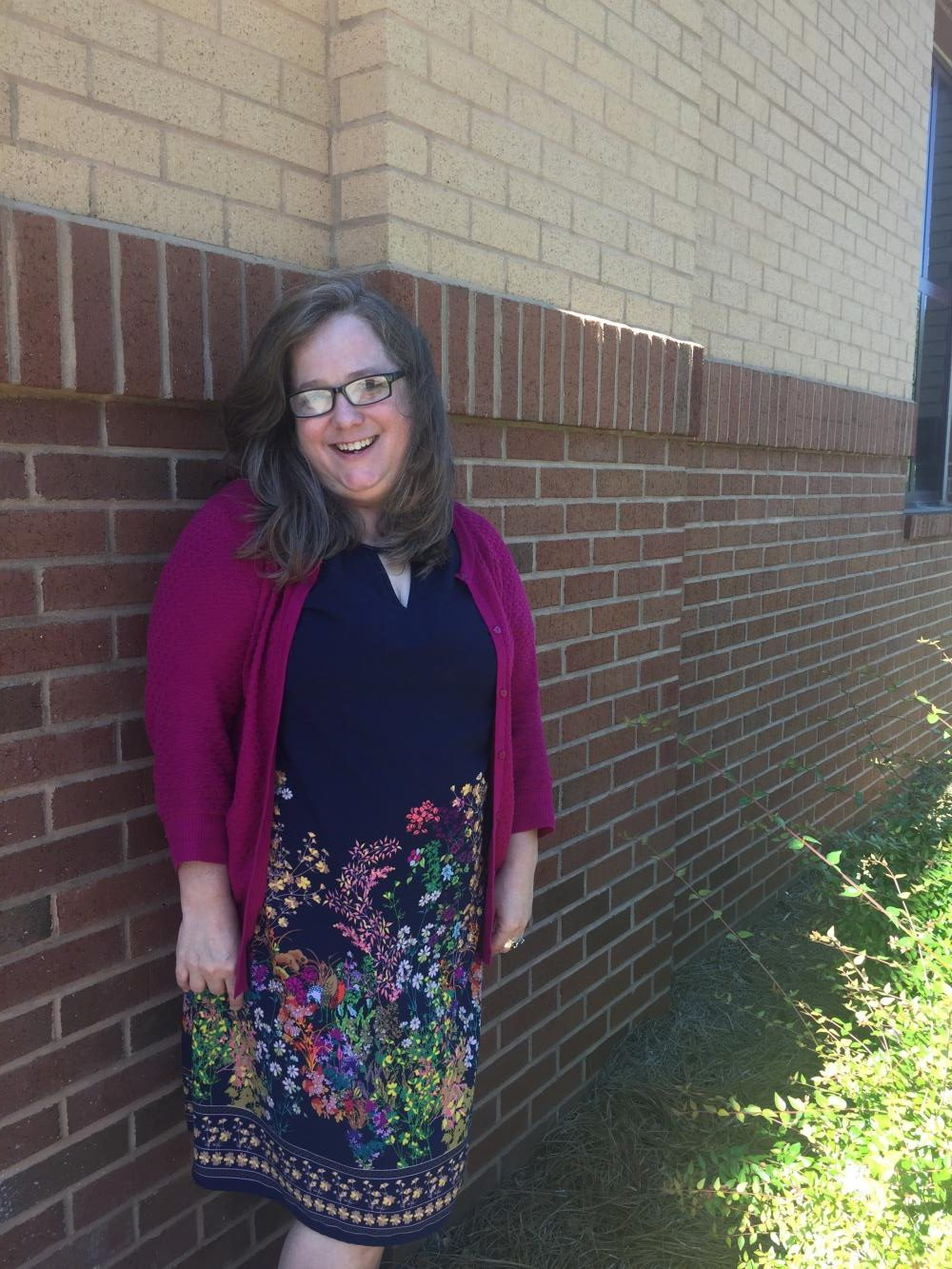 Journalism, Language and Composition, and Literature teacher, Clori Rose, poses outside for a farewell pictures as she reveals that the 2016-2017 school year is her last at Lambert.