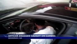 Man caught on camera dragging police officer