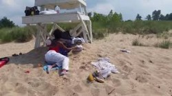 Lifeguard Caught Snoozing on the Job with Her Daughter