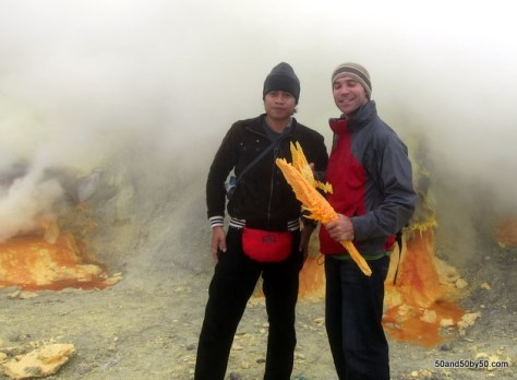 Holding sulfur at a sulfur mine at Kawah Ijen volcano | Java, Indonesia