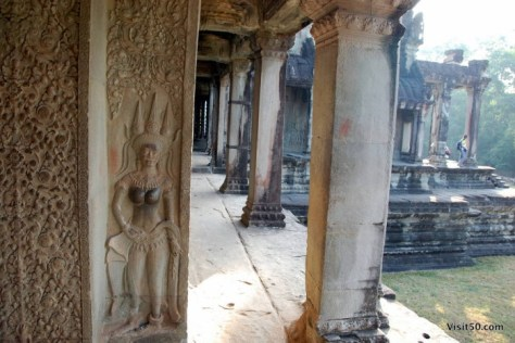 a devata graces the walls in Angkor Wat. Devata is another word for deva, the Hindu term for deity