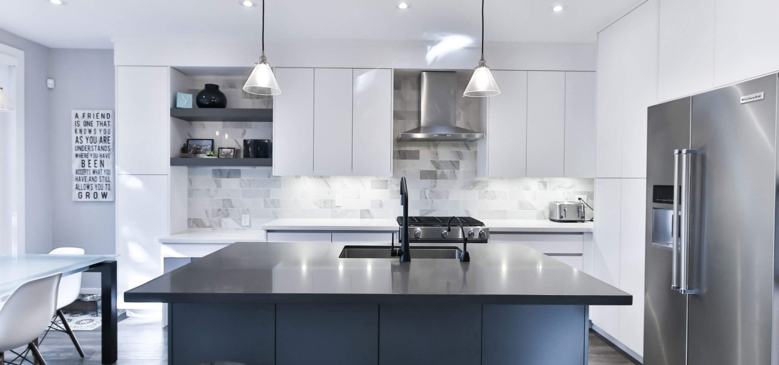 black and blue island in white kitchen