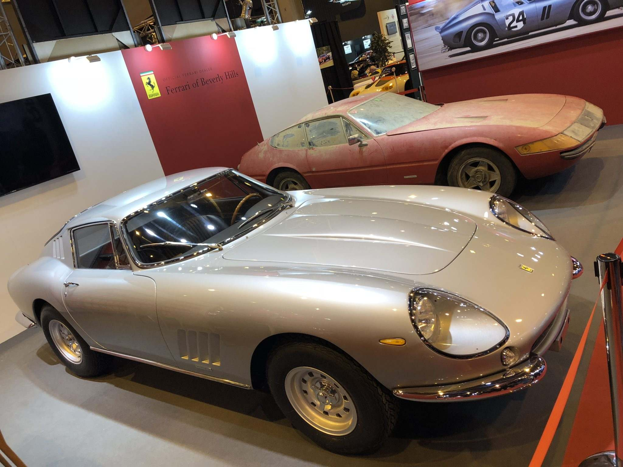 A beautiful 275 GTB/4 was at her side.