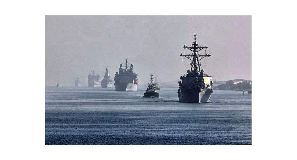 Пекин обещает «предпринять необходимые действия» после того, как британская ударная группа авиалайнеров пройдет через Южно-Китайское море
