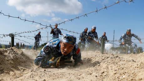 Пекин заявляет, что его военные учения возле Тайваня являются ответом на его провокации и сговор с иностранными державами