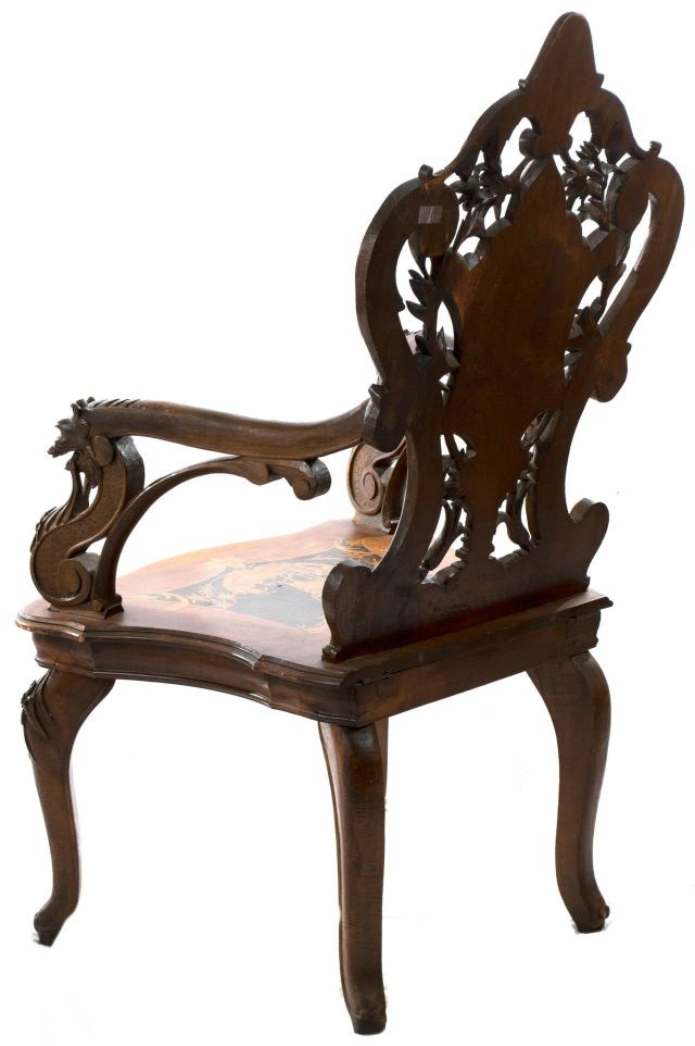 Elaborately Carved Black Forest Armchair with Hidden partment