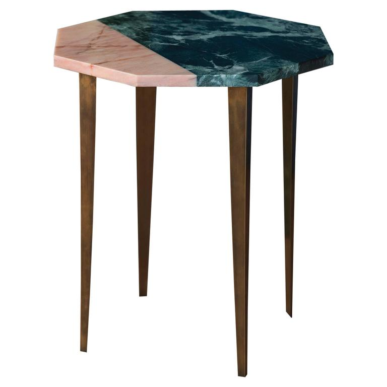 octagonal side table with green and pink marble top and tapering brass legs