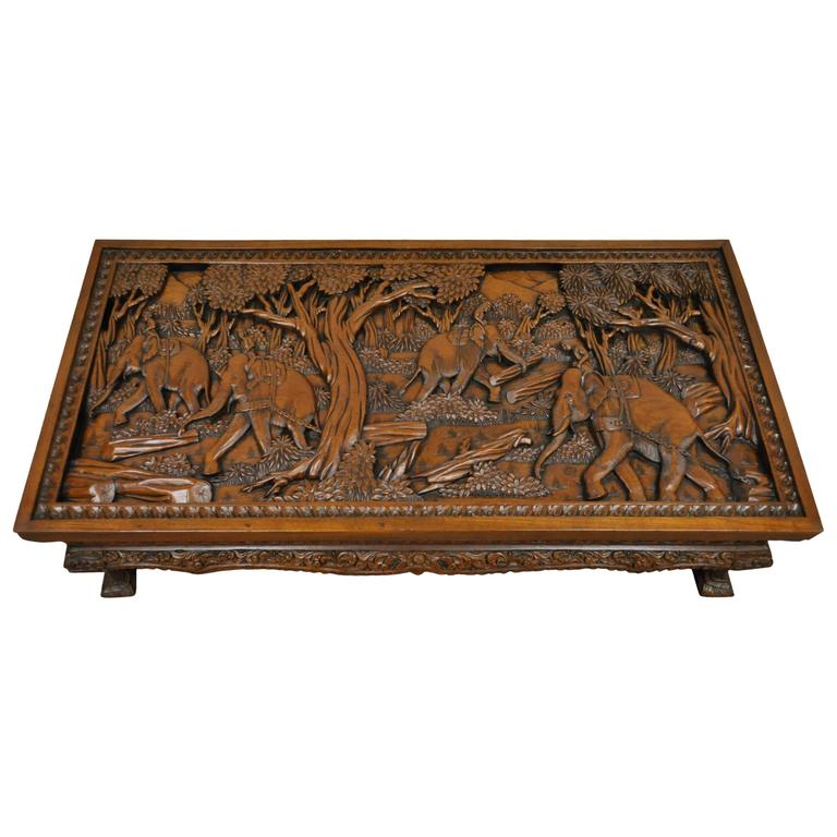 20th century vietnamese hand carved asian coffee low table with elephant scene