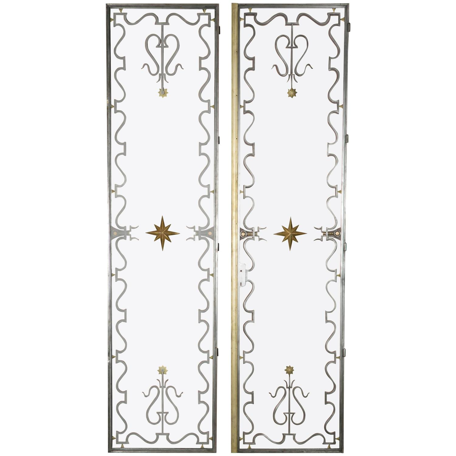 Pair Of Wrought Iron And Bronze Doors By Gilbert