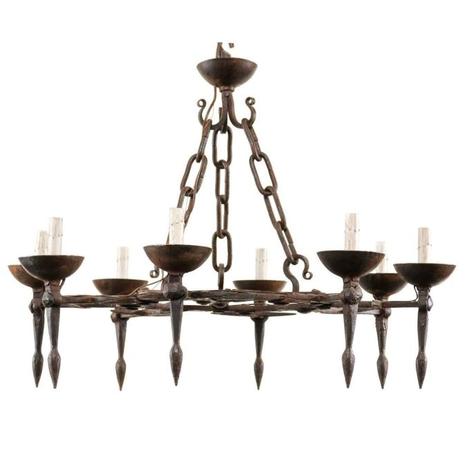 Vintage Round Iron Chandelier With Eight Torch Style Lights And Scroll Pattern For