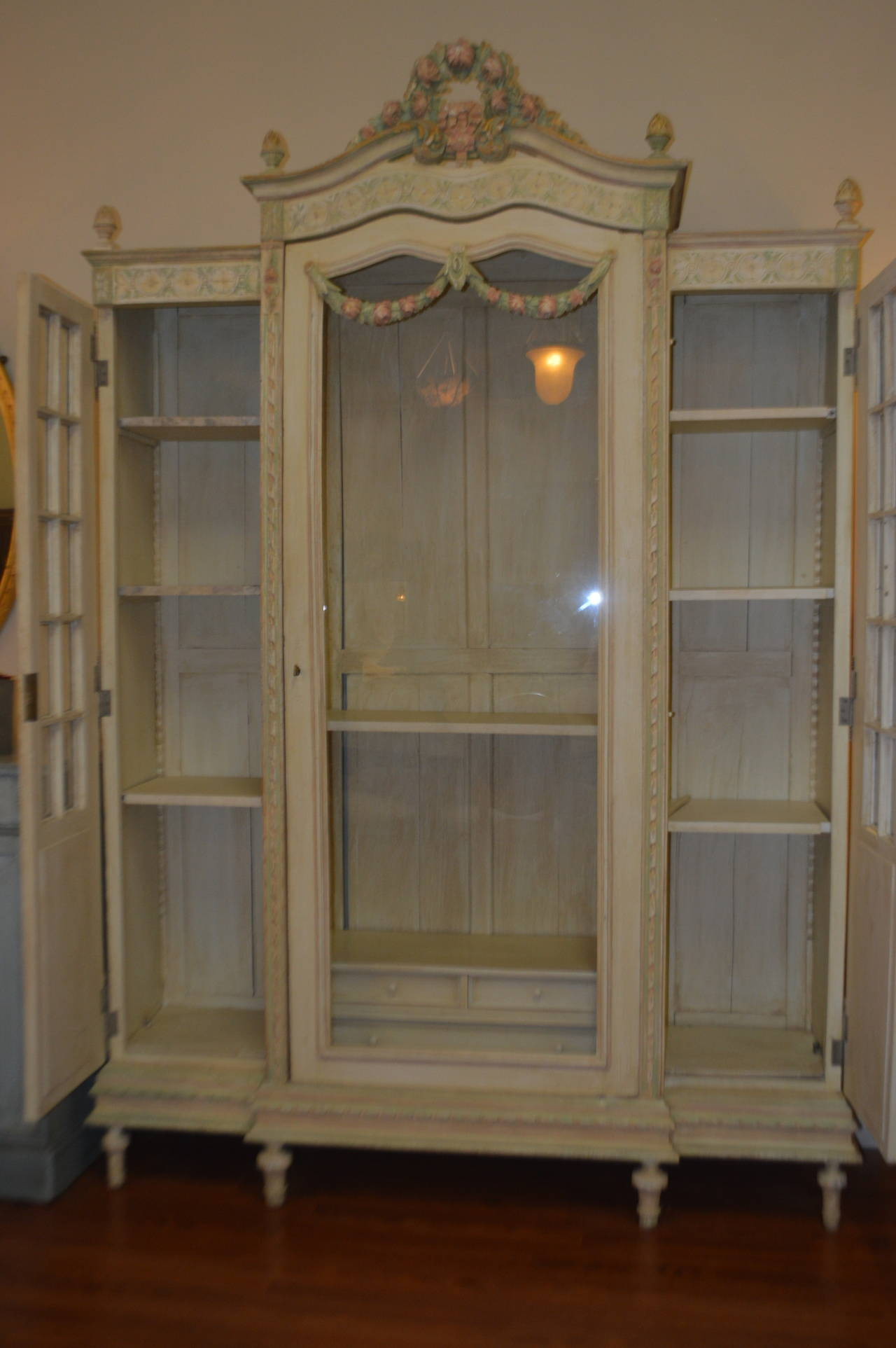 most beautiful painted armoire with glass middle door and paned glass and cane side doors