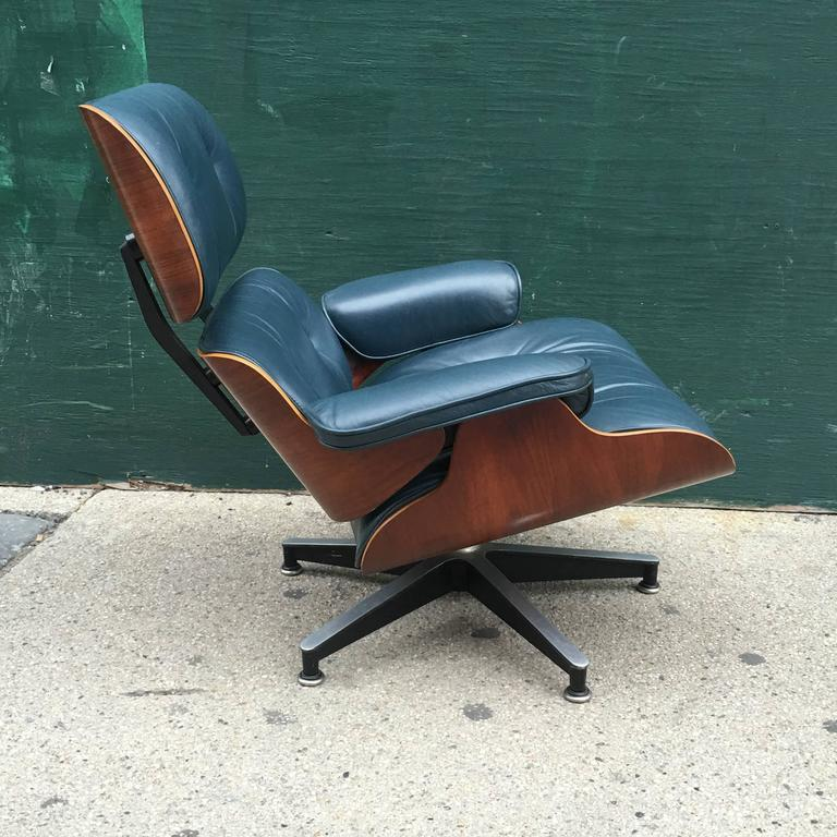 rare rosewood and navy eames lounge chair