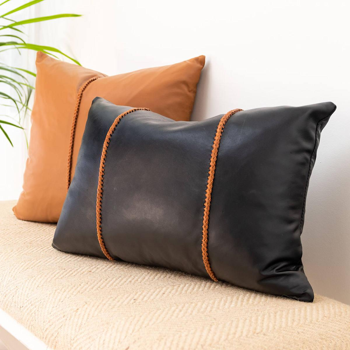 black leather pillow with tan leather cross stitch lumbar cushion