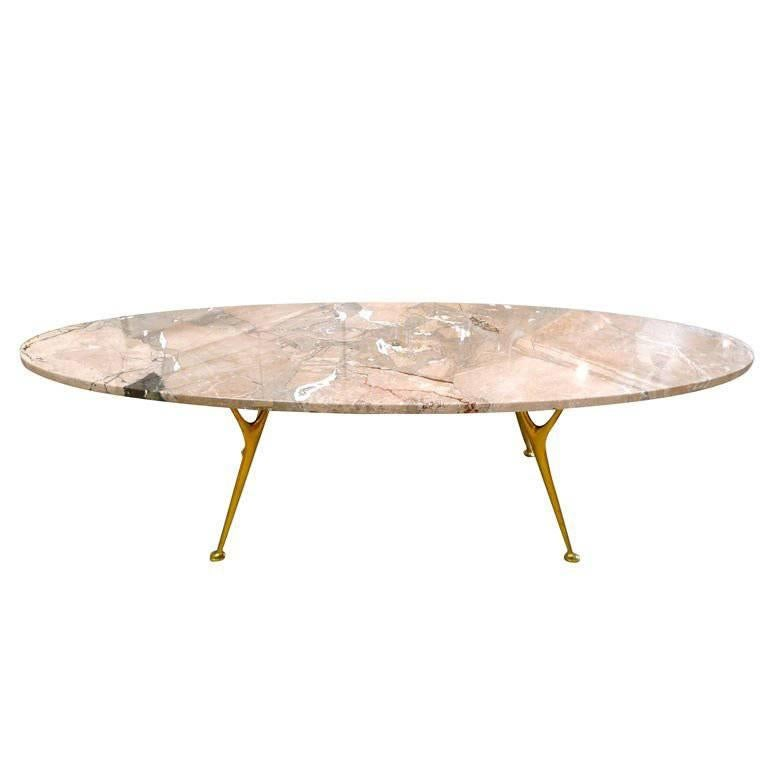 elliptical italian marble cocktail table with cast solid bronze legs