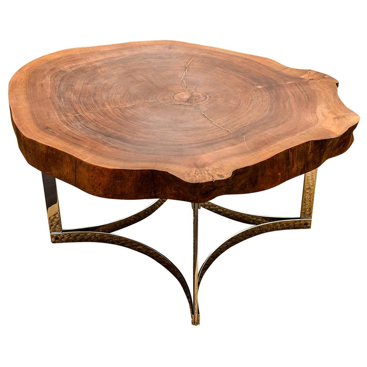 live edge wood slab coffee table on a modernist chrome base by jean hubeaux