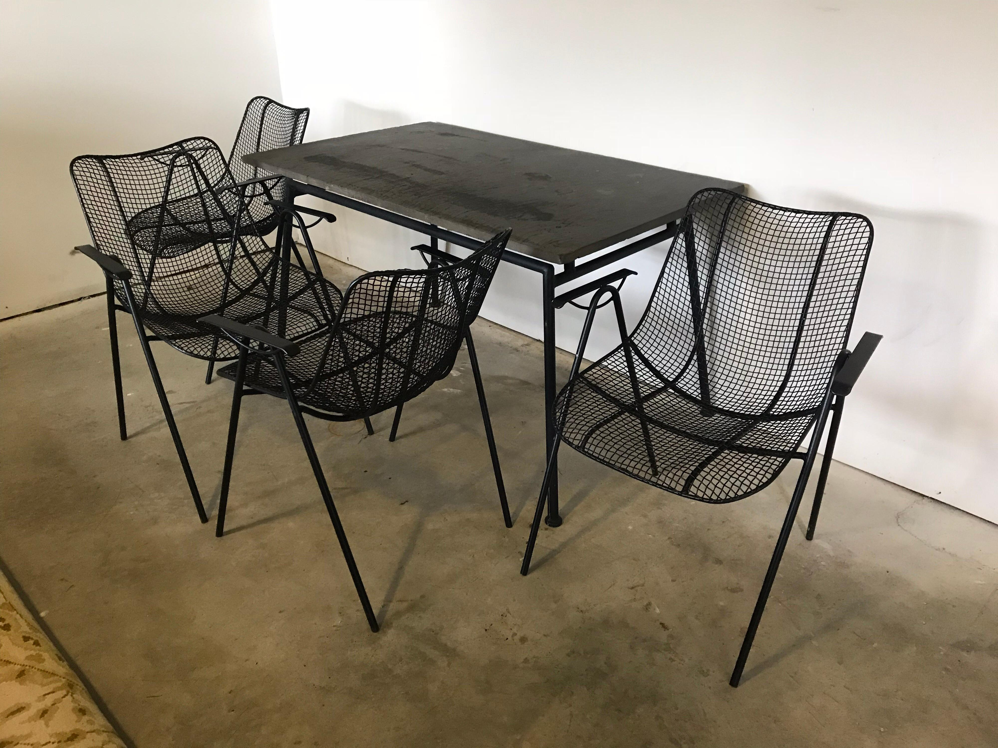 mid century woodard slate top patio table with four wrought iron chairs 1950s