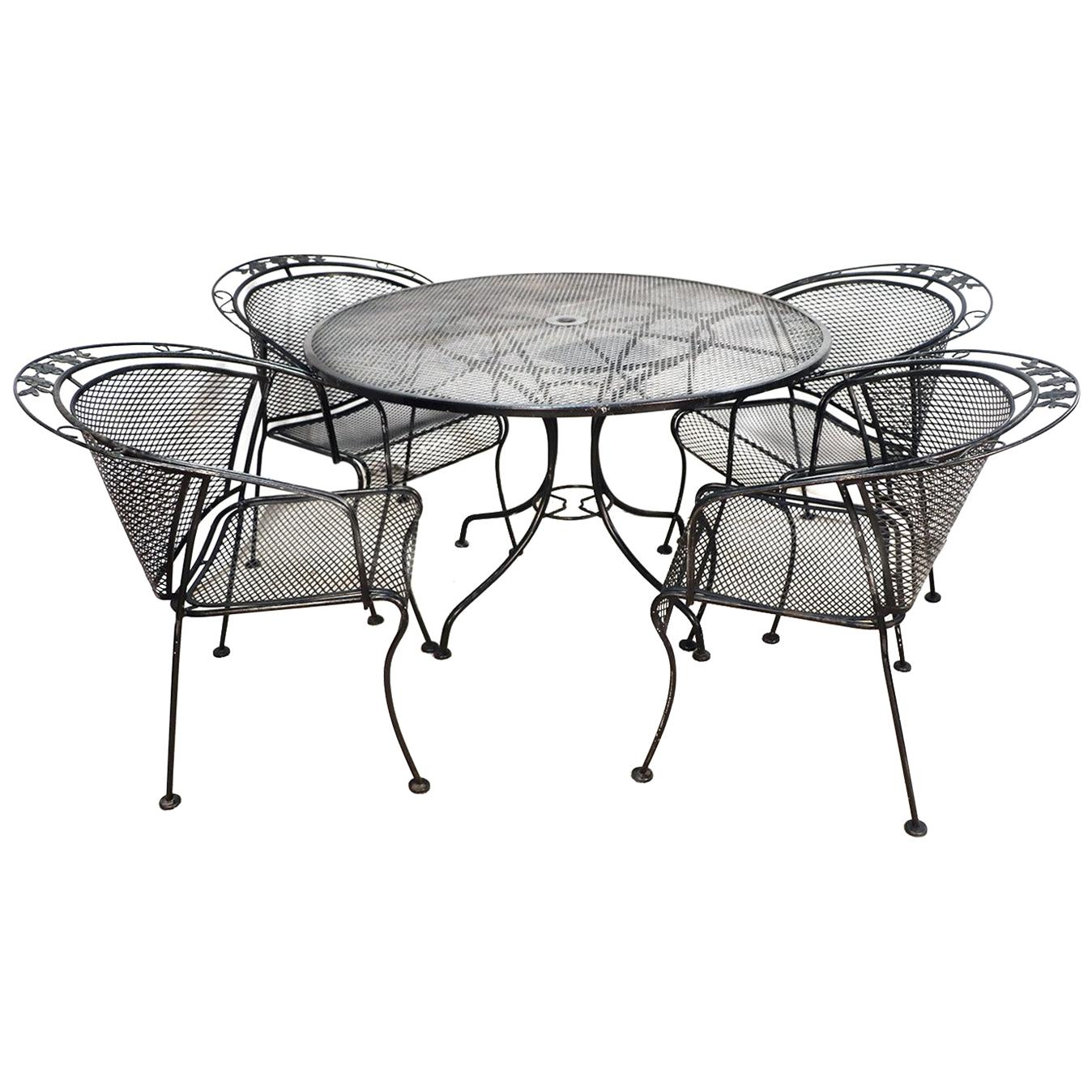 midcentury wrought iron patio set in the style of russell woodard