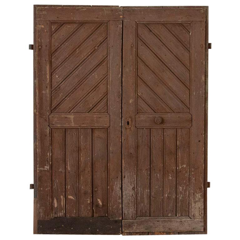 pair of antique original brown painted barn doors good for sliding doors