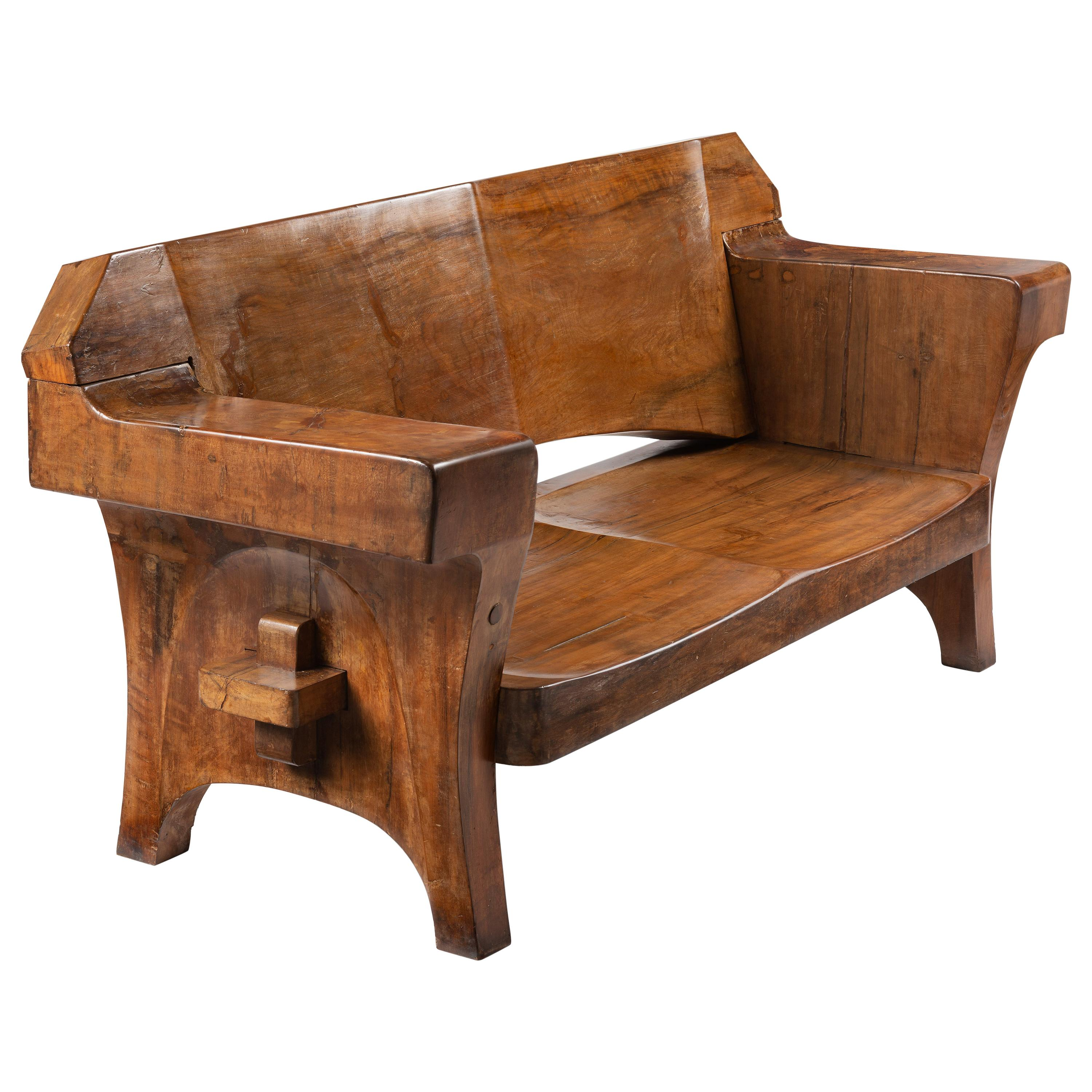 sculptural solid wood and handcrafted sofa by jose zanine caldas circa 1980