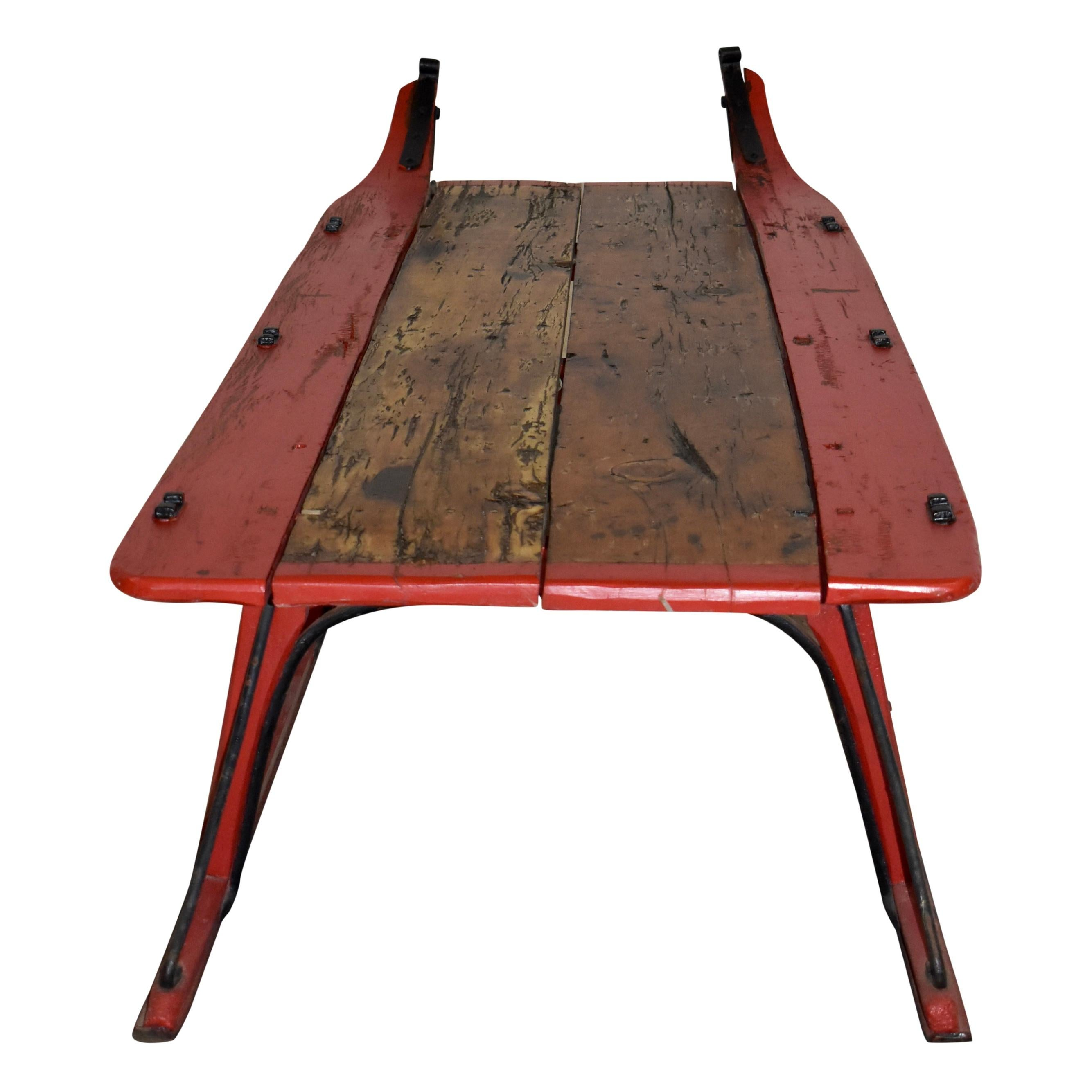 sleigh coffee table with early 20th century runners and reclaimed wood