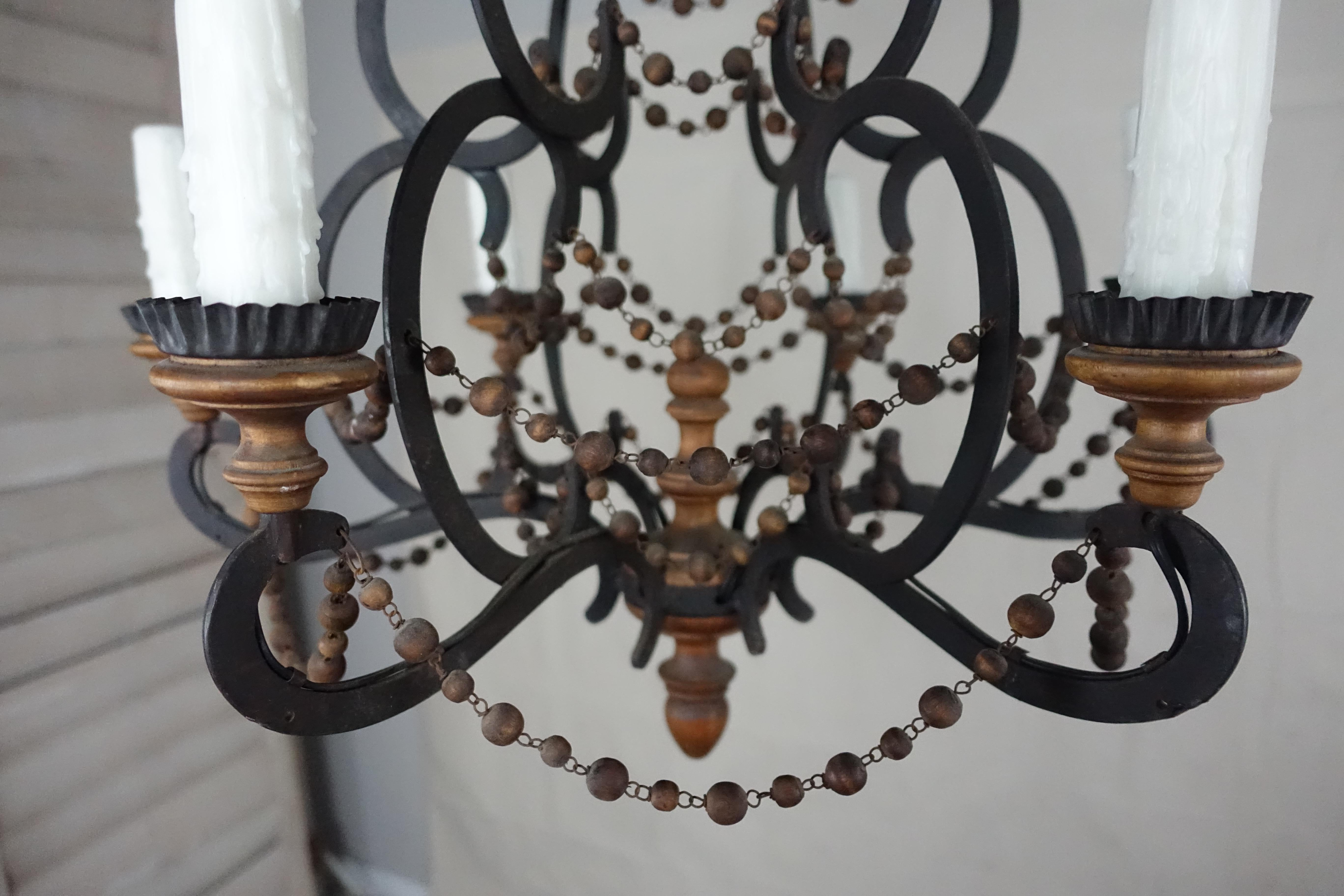 Spanish Wrought Iron And Wood Beaded Chandelier For Sale