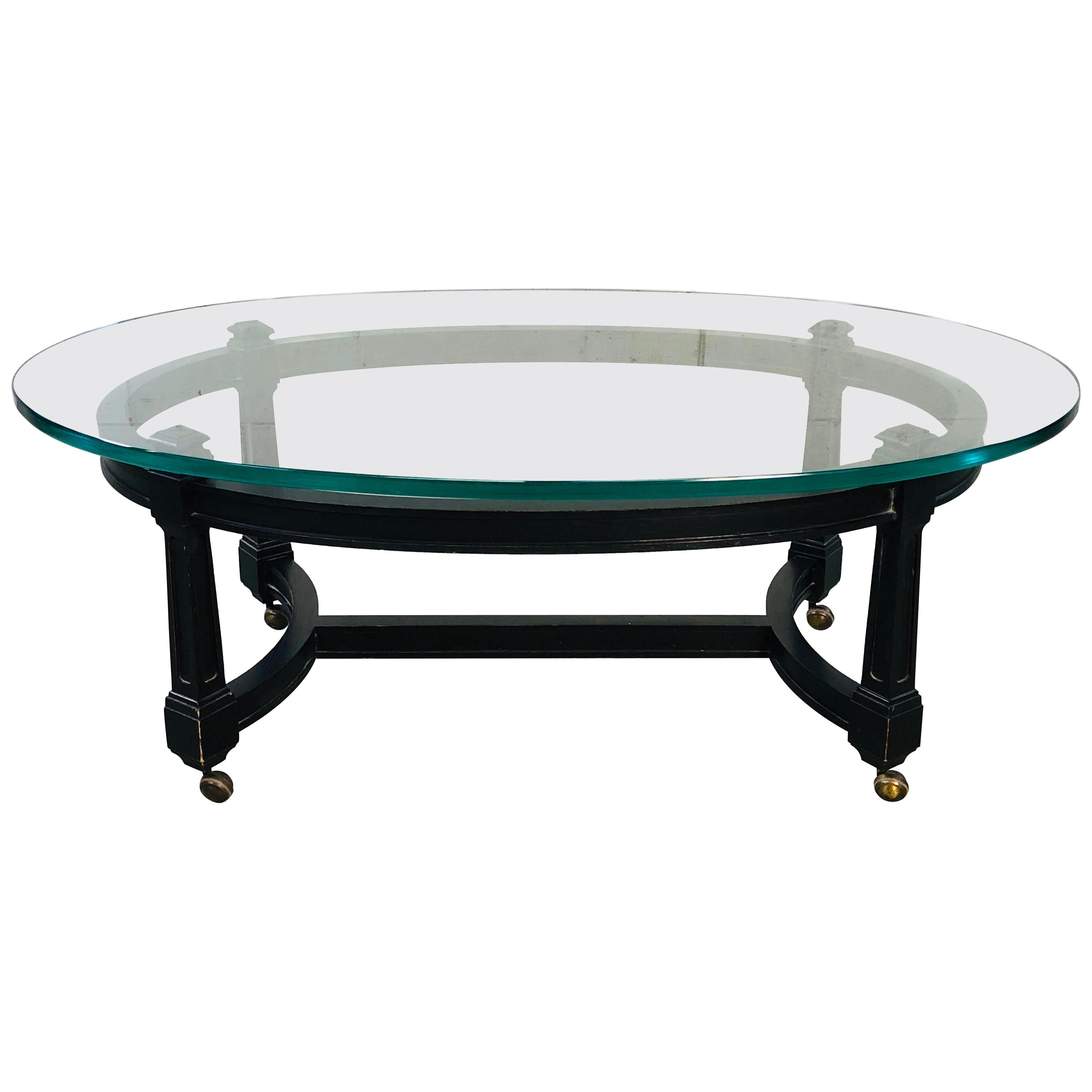 vintage oval glass top and black wood coffee table