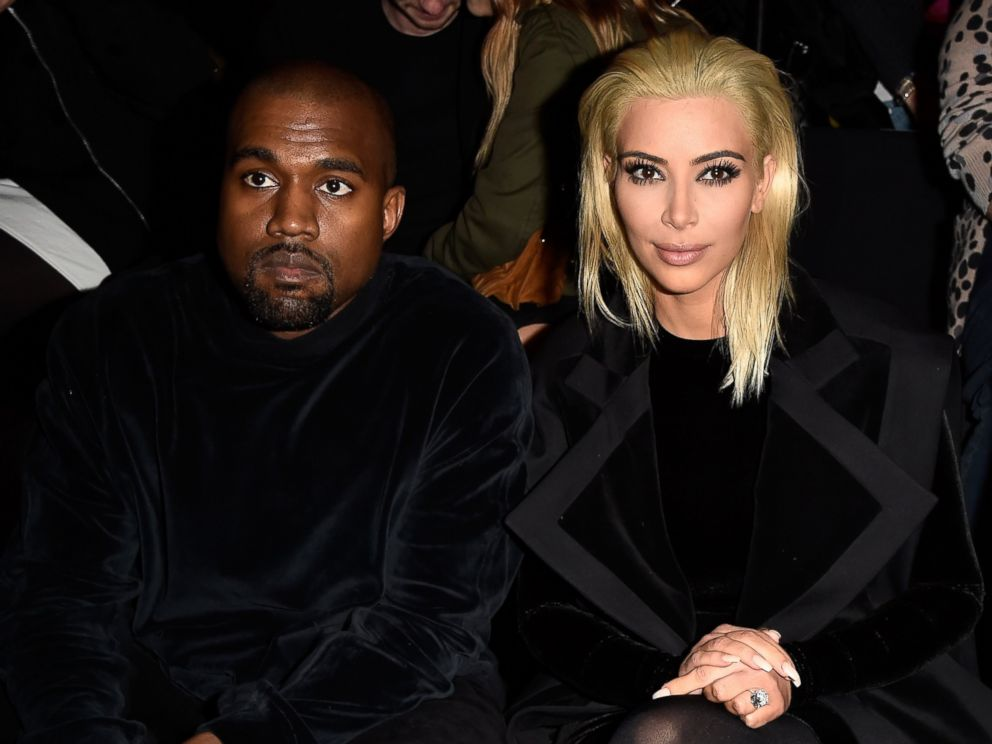 PHOTO: Kanye West and Kim Kardashian attend the Balmain show as part of the Paris Fashion Week Womenswear Fall/Winter 2015/2016, March 5, 2015, in Paris.