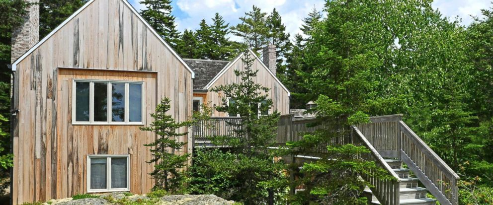 This July 2017 photo provided by the Knowles Company shows the guest house on the grounds of the summer estate of the late billionaire philanthropist David Rockefeller in Seal Harbor, Maine. The estate is on the market for $19 million, with all proce