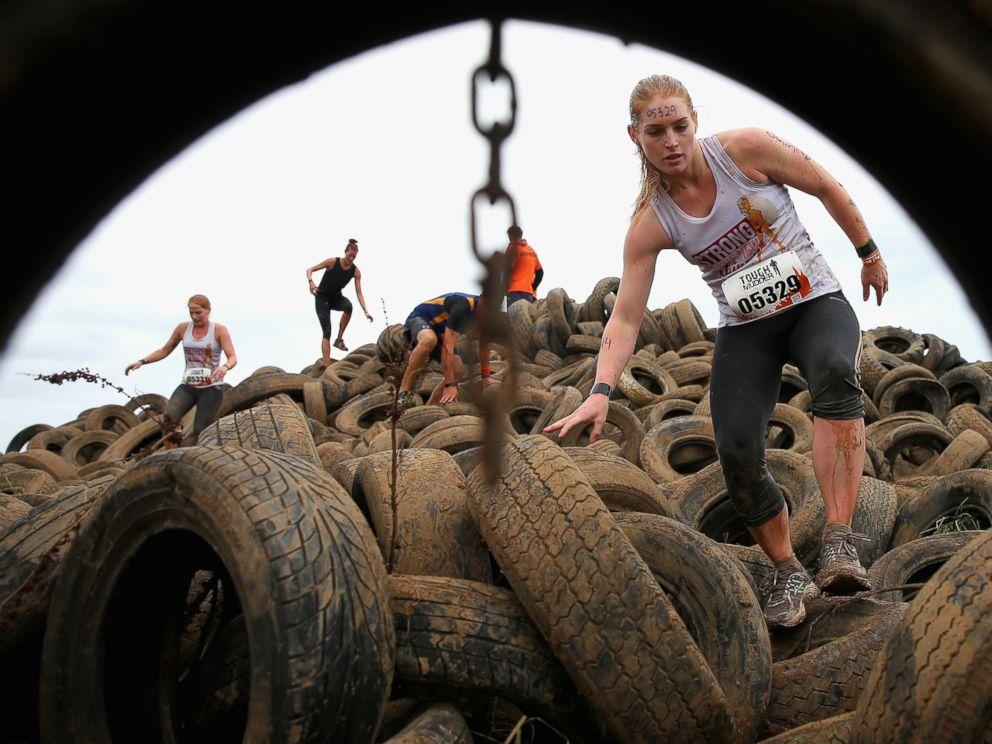 PHOTO: Competitors run over a tire pit during Toughmudder at Phillip Island Grand Prix Circuit, March 23, 2014 in Phillip Island, Australia.