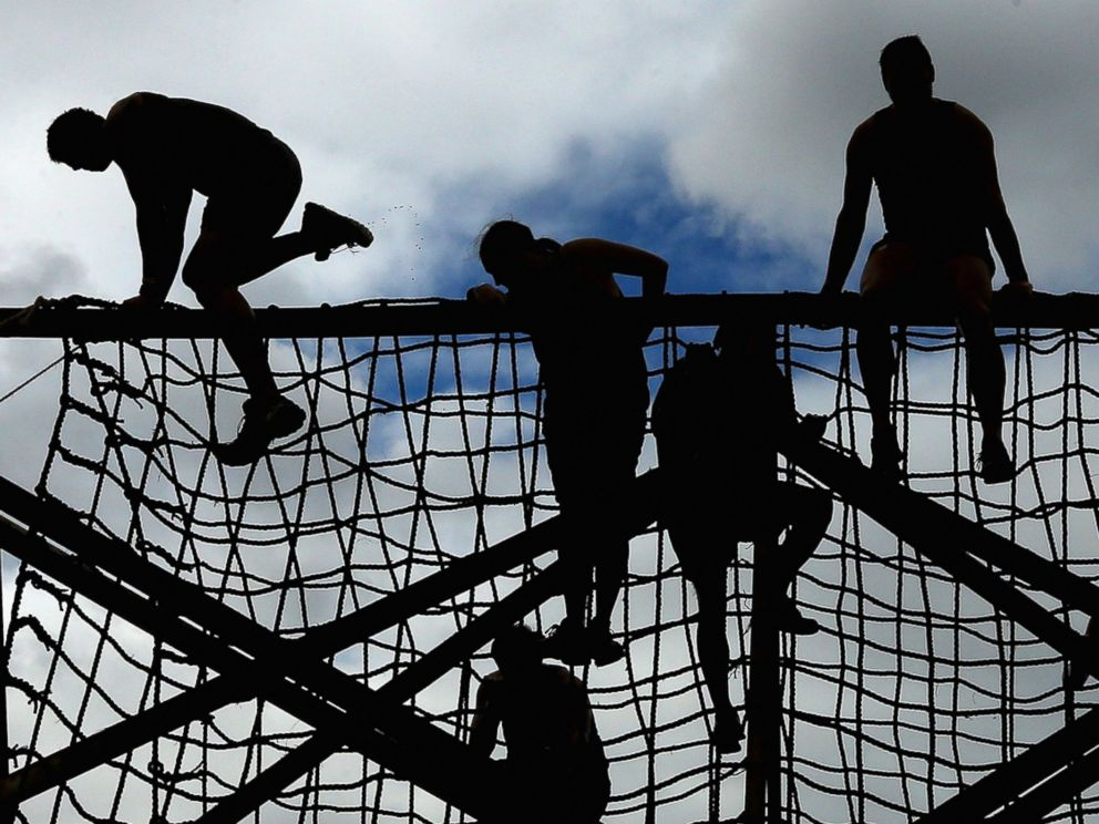 PHOTO: Competitors climb up a rope net during Toughmudder at Phillip Island Grand Prix Circuit, March 23, 2014 in Phillip Island, Australia.