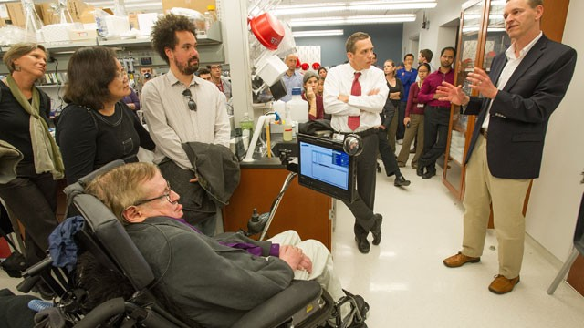 PHOTO: Stephen Hawking, listens to Robert H. Baloh, MD, PhD, the Director of Neuromuscular Medicine in the Department of Neurology, as he was given a tour of the Regenerative Medicine Institute at Cedars-Sinai Medical Center, April 9, 2013, in Los Angeles