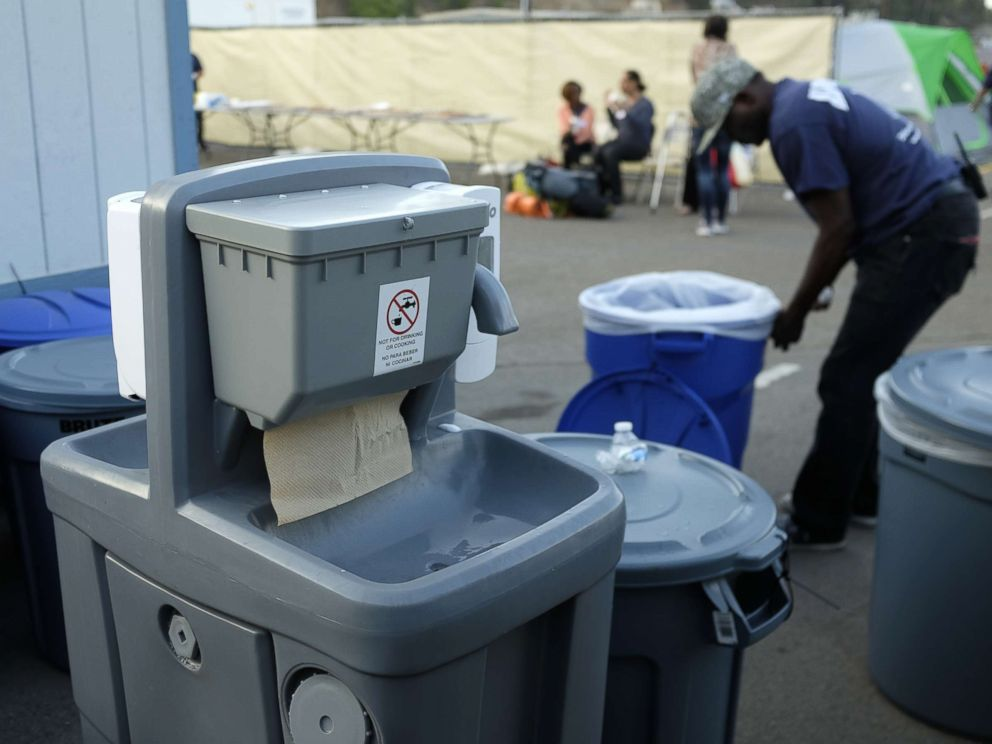 PHOTO: A hand washing station is seen near a tent city in San Diego as part of the citys efforts to combat a deadly hepatitis A outbreak, Oct. 9, 2017.