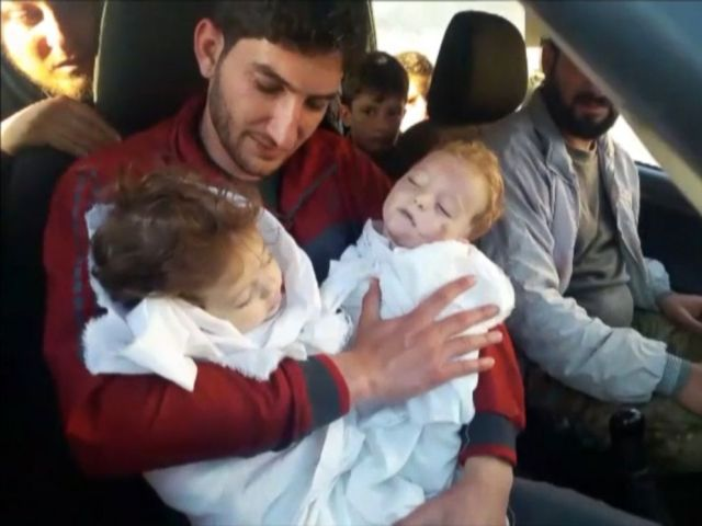 PHOTO: Abdel Hameed al-Youssef cradles the bodies of his nine month old twins after they were killed in a suspected chemical attack on Idlib in Syria on April 4, 2017.