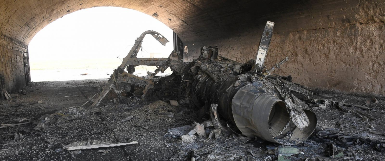 PHOTO: In a photo released by the Russian state-owned news outlet, Sputnik, the body of the remains of a plane burned following the U.S. missile attack on an air base in Syria, April 7, 2017.