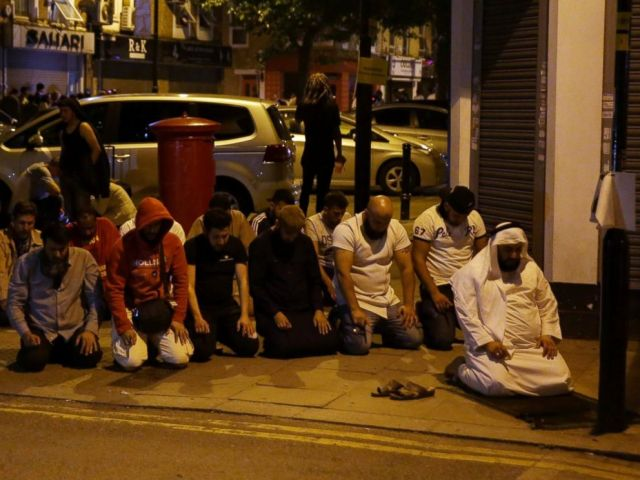 PHOTO: Muslims pray on a sidewalk in the Finsbury Park area of north London after a vehicle hit pedestrians, on June 19, 2017.