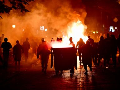 PHOTO: Protesters erect burning barricades in front of the Rote Flora left-wing centre after the Welcome to Hell protest march, July 6, 2017, in Hamburg, Germany.