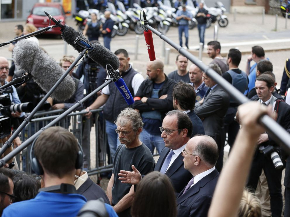 PHOTO: French President Francois Hollande speaks to the press as he leaves the Saint-Etienne-du-Rouvrays city hall following a hostage-taking at a church of the town on July 26, 2016 that left the priest dead.