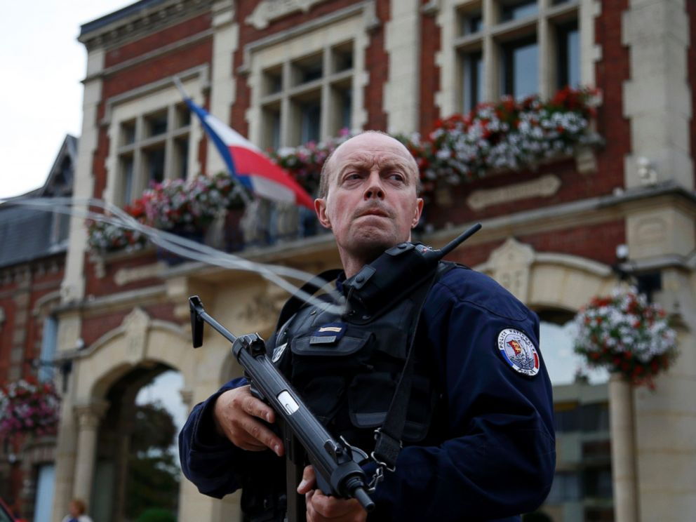 PHOTO: A policeman secures a position in front of the city hall after two assailants had taken five people hostage in the church at Saint-Etienne-du-Rouvray near Rouen in Normandy, France, July 26, 2016.