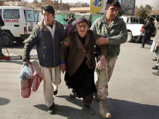 PHOTO: An wounded elderly woman is assisted at the site of a deadly suicide attack in the center of Kabul, Afghanistan, Jan. 27, 2018.