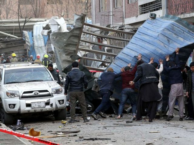 PHOTO: People try to remove debris from the scene of a suicide bomb attack in Kabul, Afghanistan, Jan. 27, 2018.