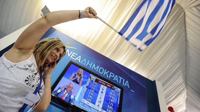PHOTO: New Democracy (ND) party supporters celebrate as they watch the exit polls at the party's main election campaign kiosk in Athens on June 17, 2012.