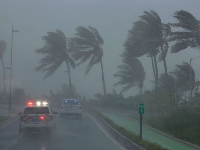 PHOTO: Police patrol the area as Hurricane Irma slams across islands in the northern Caribbean on Wednesday, in San Juan, Puerto Rico Sept. 6, 2017.