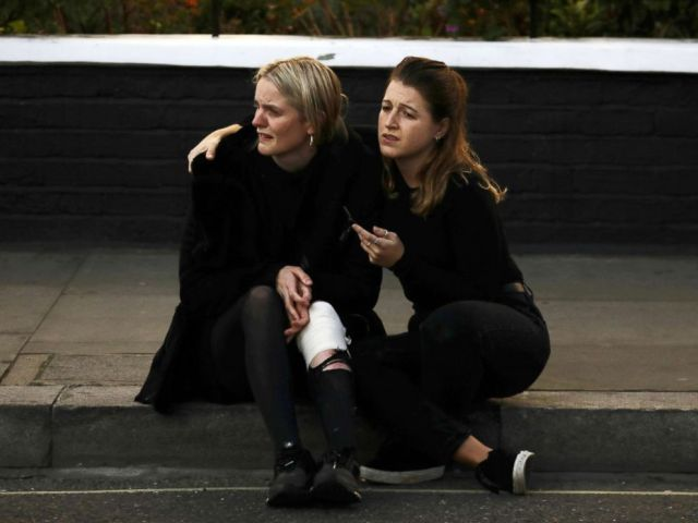 PHOTO: An injured woman reacts outside Parsons Green tube station in London, Sept. 15, 2017.