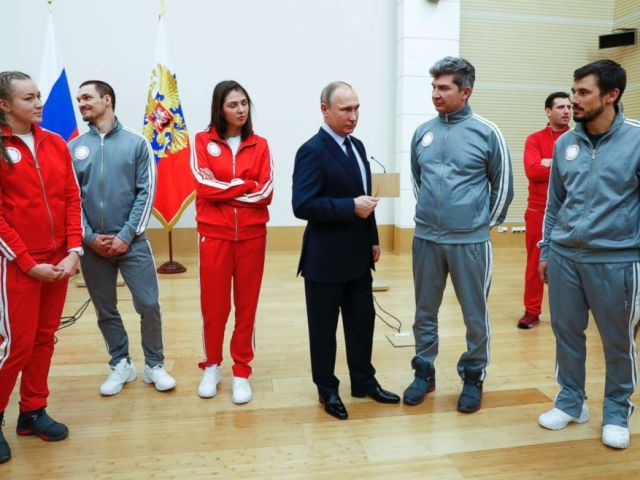 PHOTO: Russian President Vladimir Putin, center, with Russian athletes who will take part in the upcoming 2018 Pyeongchang Winter Olympic Games in South Korea, at the Novo-Ogaryovo residence outside in Moscow, Russia, Jan. 31, 2018.