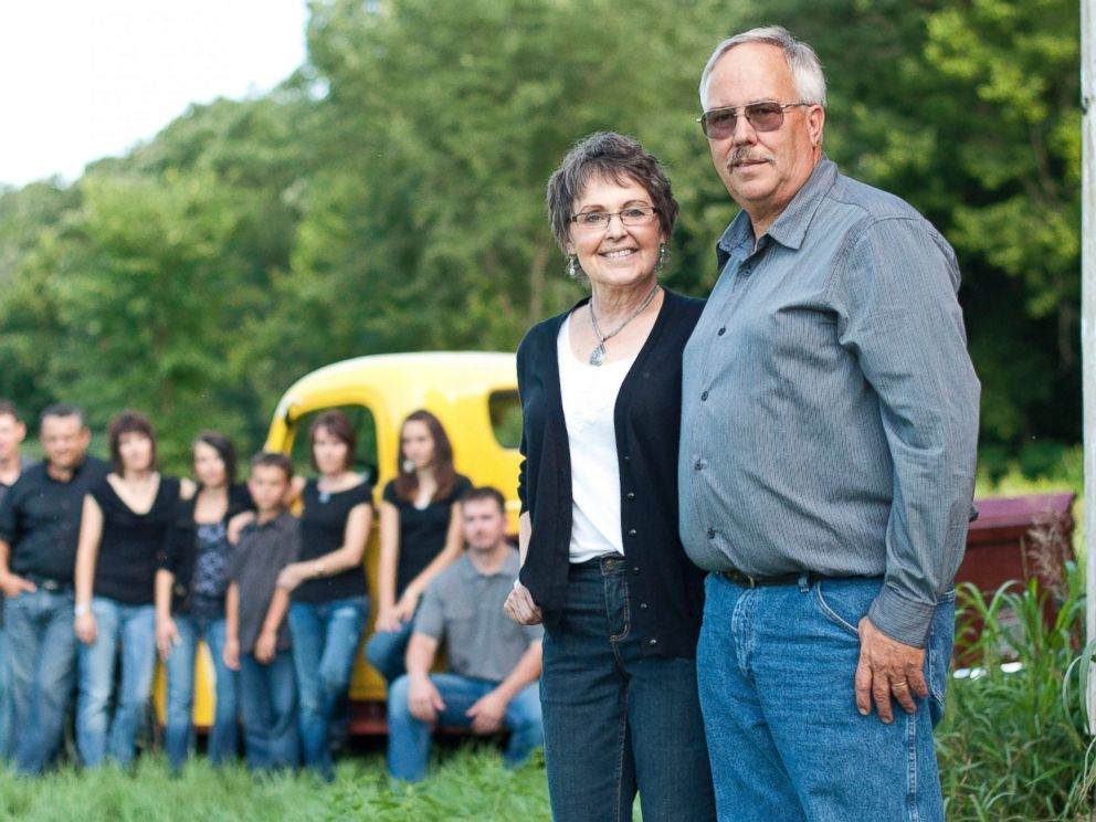 PHOTO: Don and Babbette Jaquish stand in their sunflower field with their family in the background in a photo taken in 2011.