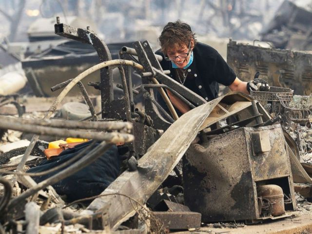 PHOTO: Kris Pond reacts as she searches the remains of her familys home destroyed by fires in Santa Rosa, Calif., Oct. 9, 2017.