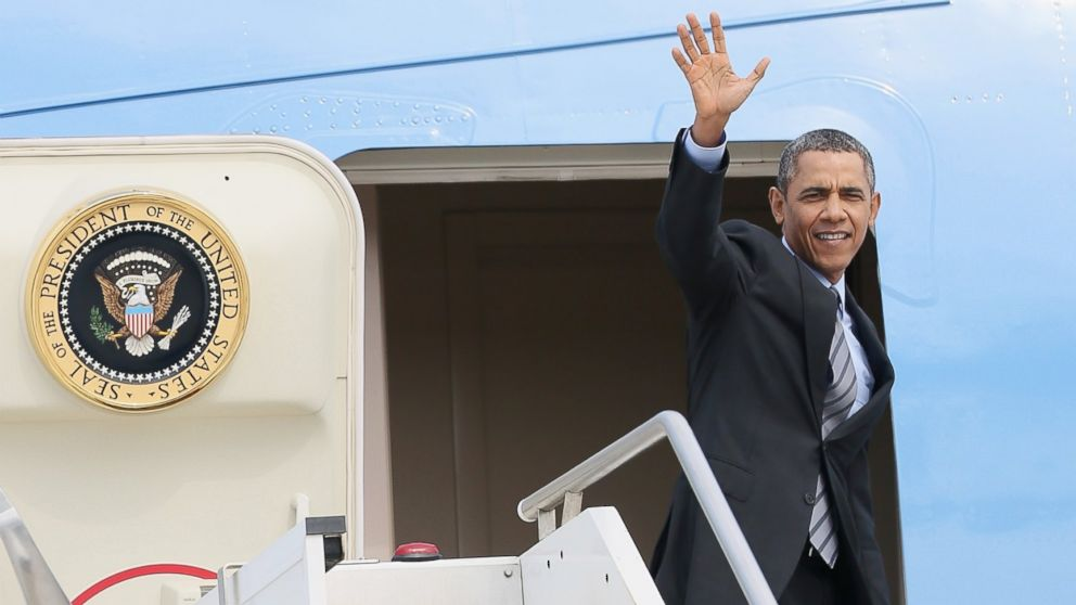 PHOTO: Barack Obama waves as he walks down the stairs from Air Force One at Fiumicino Airport on March 28, 2014 in Rome, Italy.