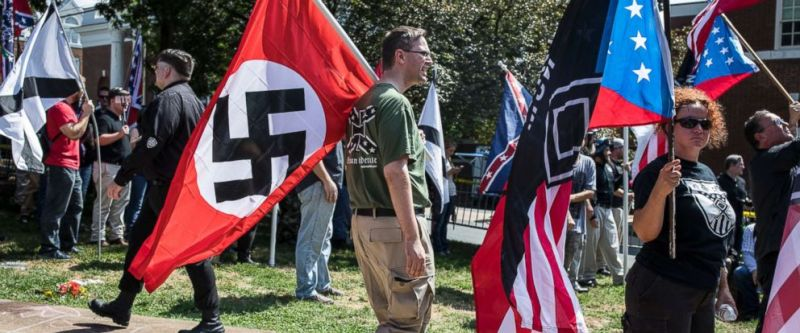 Photo A White Nationalist Carries The Nazi Flag During A Unite The Right